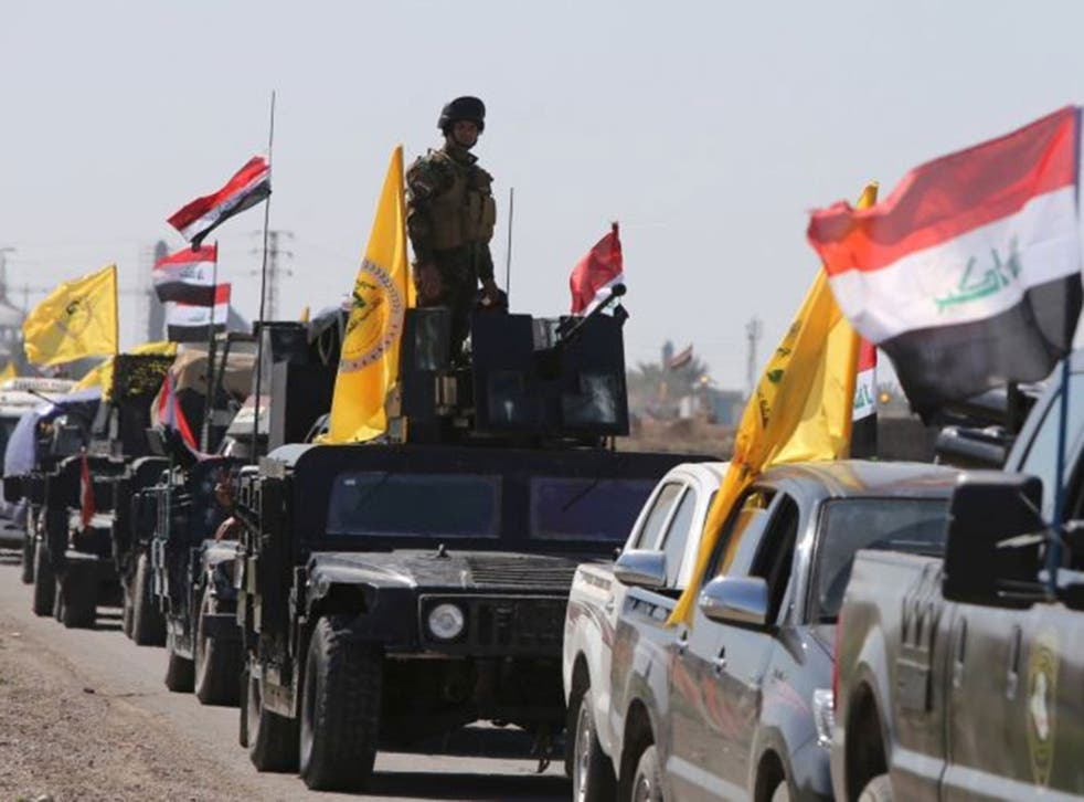 Iraqi soldiers heading from the city of Samarra north of Baghdad drive towards Tikrit to launch an assault against Isis on February 28, 2015.
