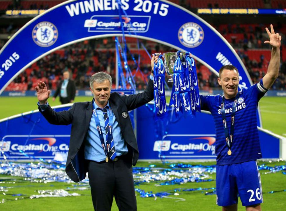 Chelsea manager Jose Mourinho (left) and captain John Terry celebrate winning the Capital One Cup final against Spurs at Wembley