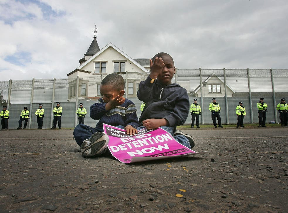 Three-year-old Ahmad Ilunga, left, and his brother Jay, four, join protesters from G8 Alternatives outside Dungavel Dentention Centre in 2005
