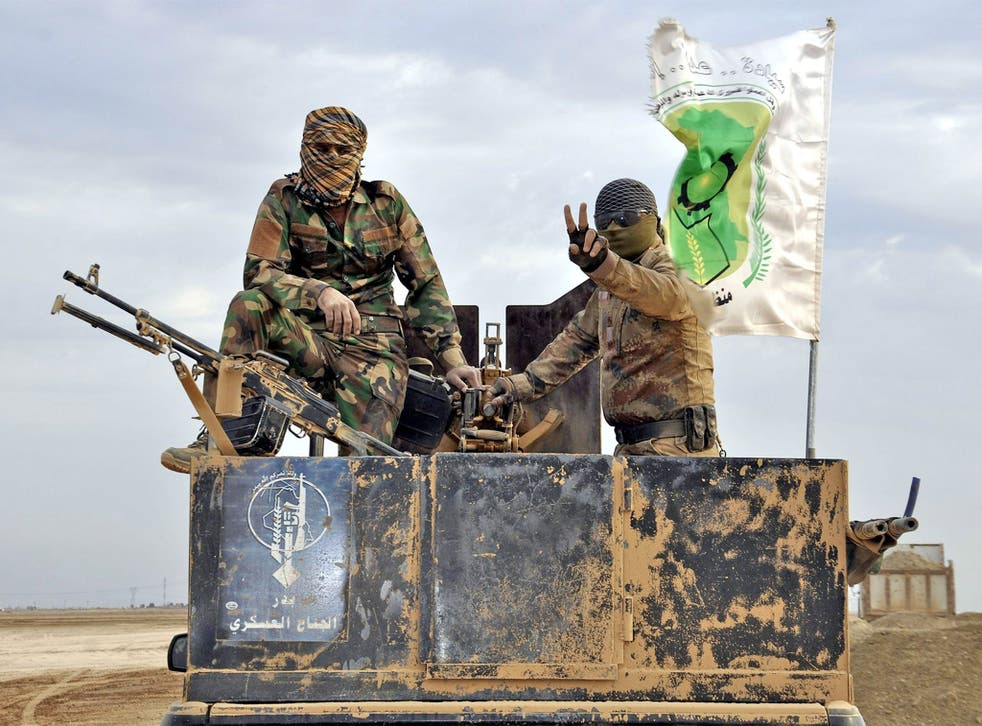 Iraqi Shias of the Badr Army militia take up position near Samara, northern Iraq, amid reports that Baghdad's forces are poised to advance on Tikrit as their offensive goes on