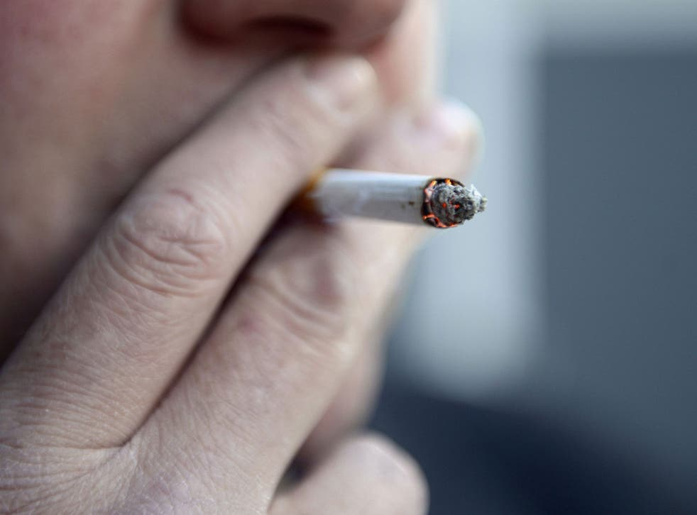 File photo of a man smoking a cigarette, as a prisoner won a landmark ruling that the ban on smoking in public places applies to state prisons and all Crown premises