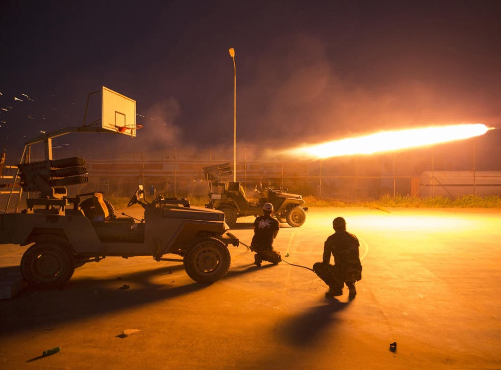 Isis fighters have set fire to oil wells northeast of the city to obstruct the assault
