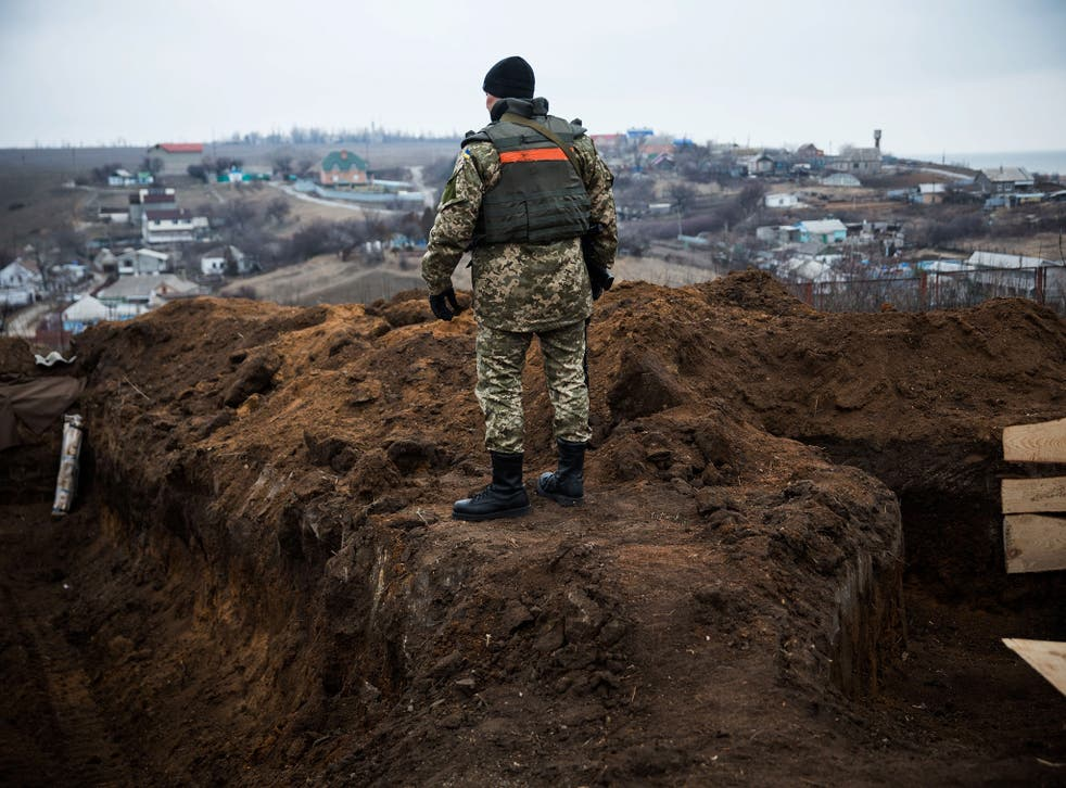 A Ukrainian soldier stands near the front line of defence against pro-Russian separatists near the village of Berdianske on the eastern side of Mariupol