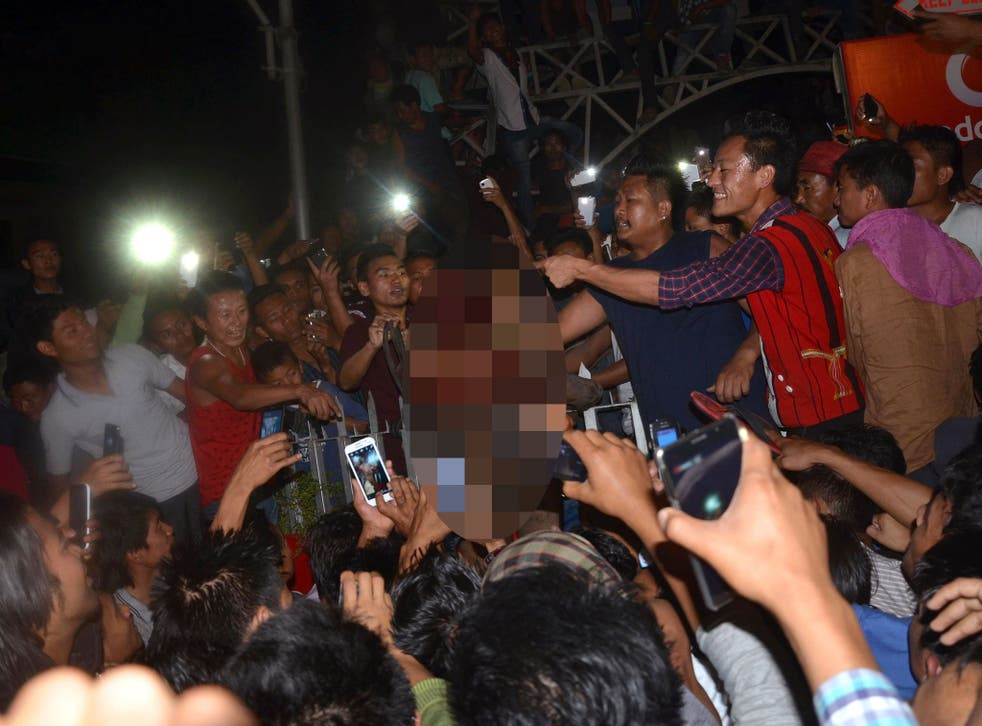 A crowd of Indian men surround an alleged rapist after he was dragged out of prison and beaten to death in Dimapur in the northeastern Indian state of Nagaland