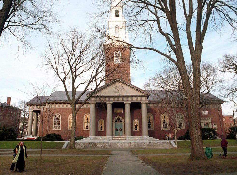 People walk around the Harvard University's main campus