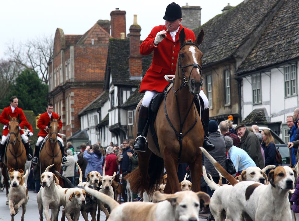Fox hunters ride through the village of Lacock during a traditional Boxing Day Hunt in 2011