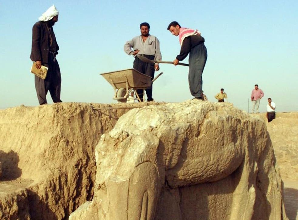 Isis militants have bulldozed the ancient city of Nimrud, pictured here undergoing maintenance in 2001