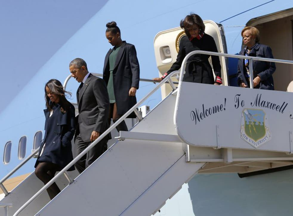 Barack Obama and his daughters arriving in Alabama on Saturday