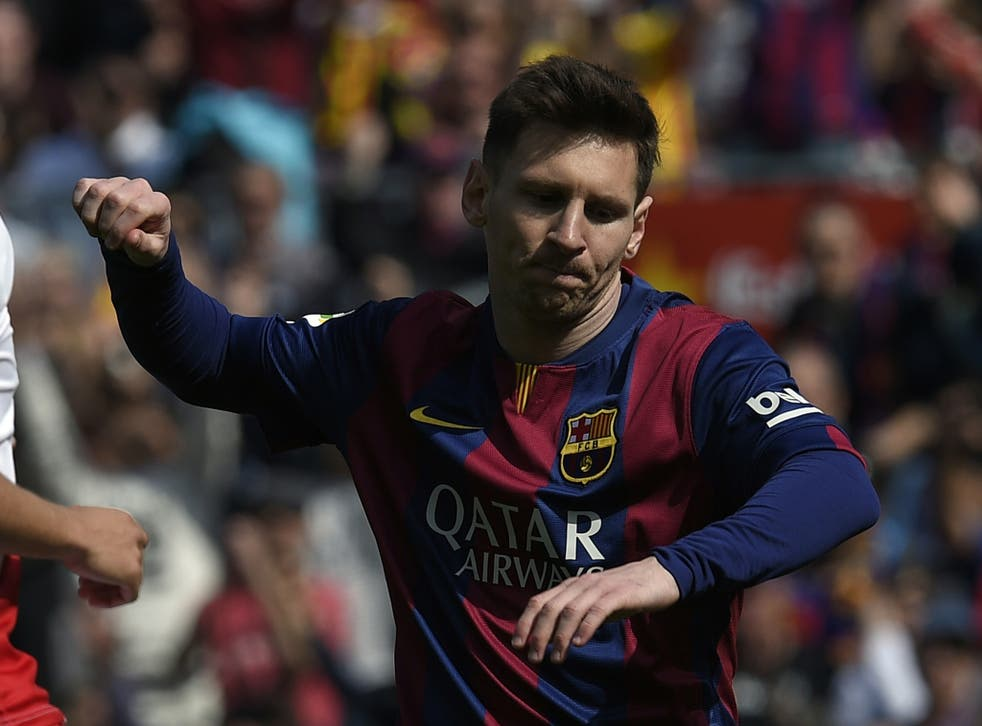 Barcelona's Argentinian forward Lionel Messi celebrates after scoring during the Spanish league football match FC Barcelona vs Rayo Vallecano