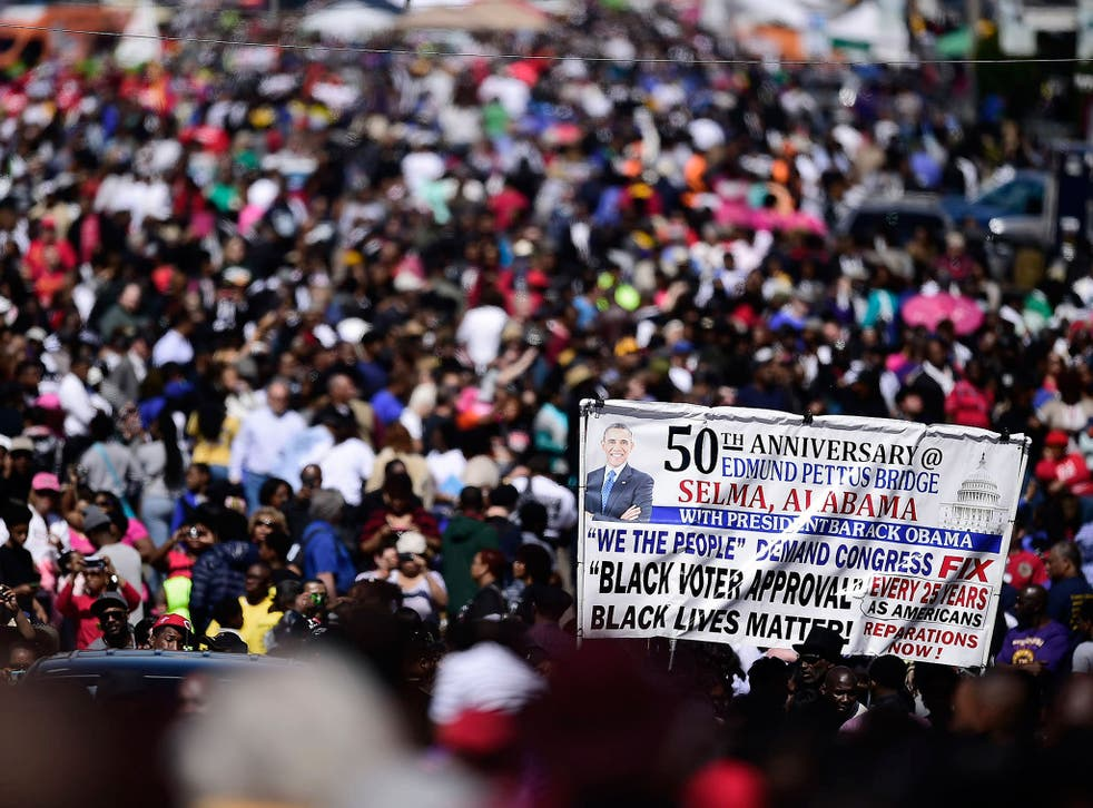 The predominately black crowds that gathered near the Edmund Pettus Bridge in Selma appeared to be as concerned with the present as much as the past