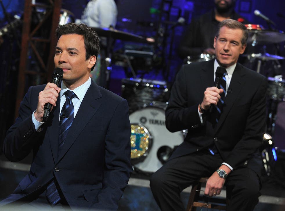 Brian Williams (L) and Jimmy Fallon appear on the Late Night with Jimmy Fallon at the Rockefeller Center on 2 March, 2011, in New York City