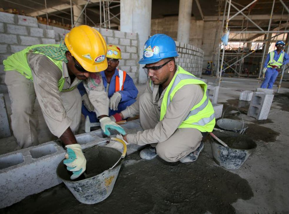 Migrant labourers work on a construction site in Doha in Qatar. Widespread abuses of migrant workers have been documented since the country was chosen to host the 2022 World Cup