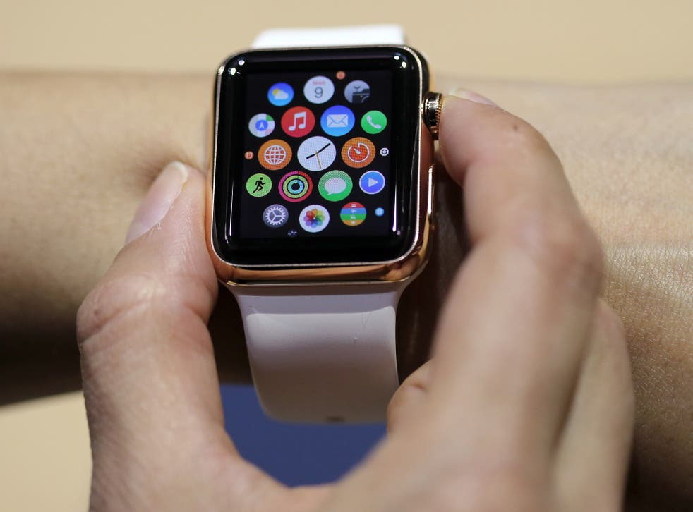 The watch has Siri built in, and doesn't require a button to activate it