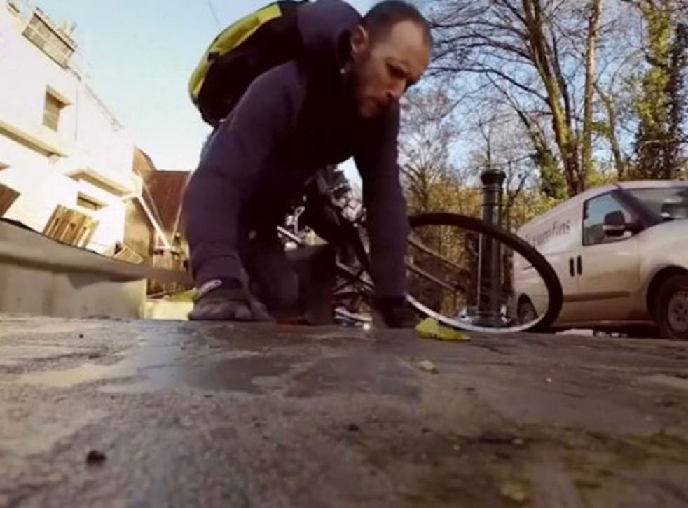 Brussels cyclist takes a hit on one of the city's cycle lanes
