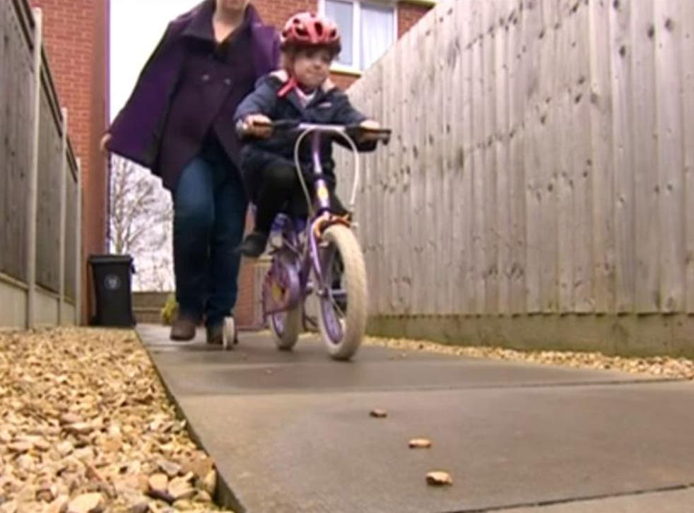 Sophie Lindley riding her bike in Grantham (BBC)