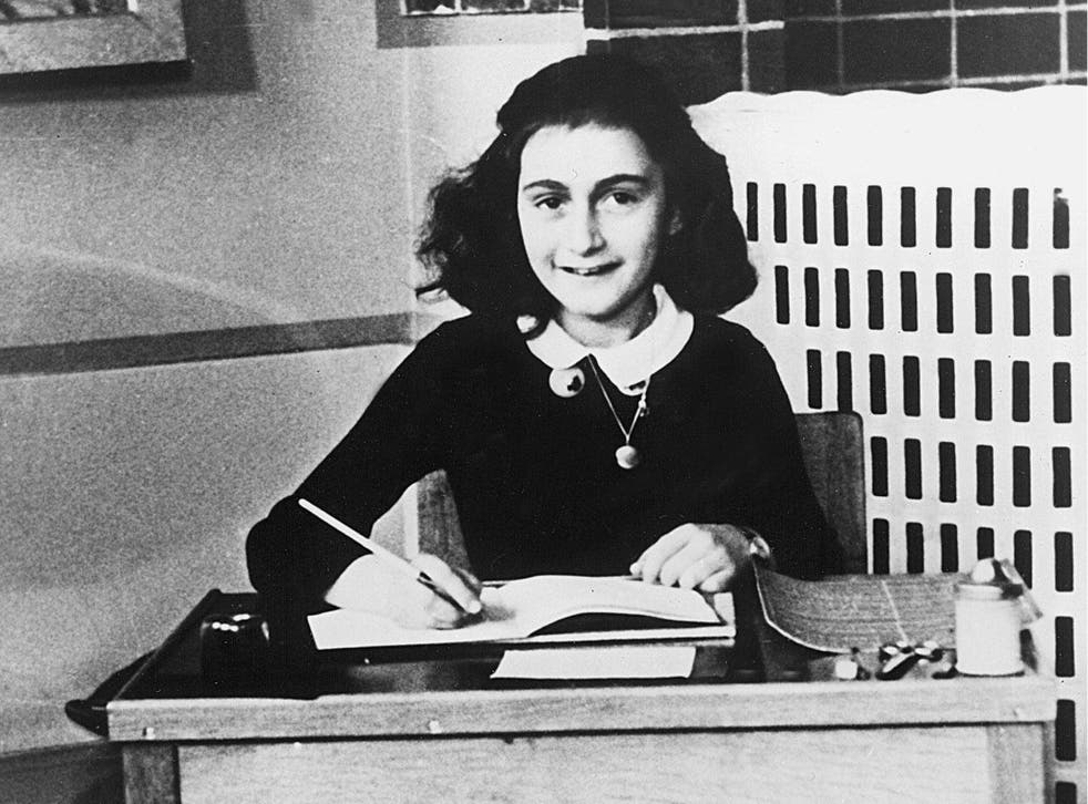 Anne Frank writing in her diary in the 1940s