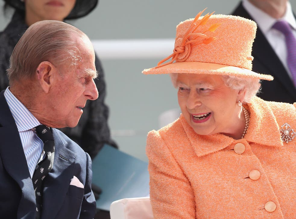 The Queen Elizabeth chats to Prince Philip as the Royal couple take part in the naming ceremony for the P&O Cruises vessel at Ocean Cruise Terminal in Southampton, England. Britannia will carry over 3647 passengers and at 141,000 tonnes she will boost P&O