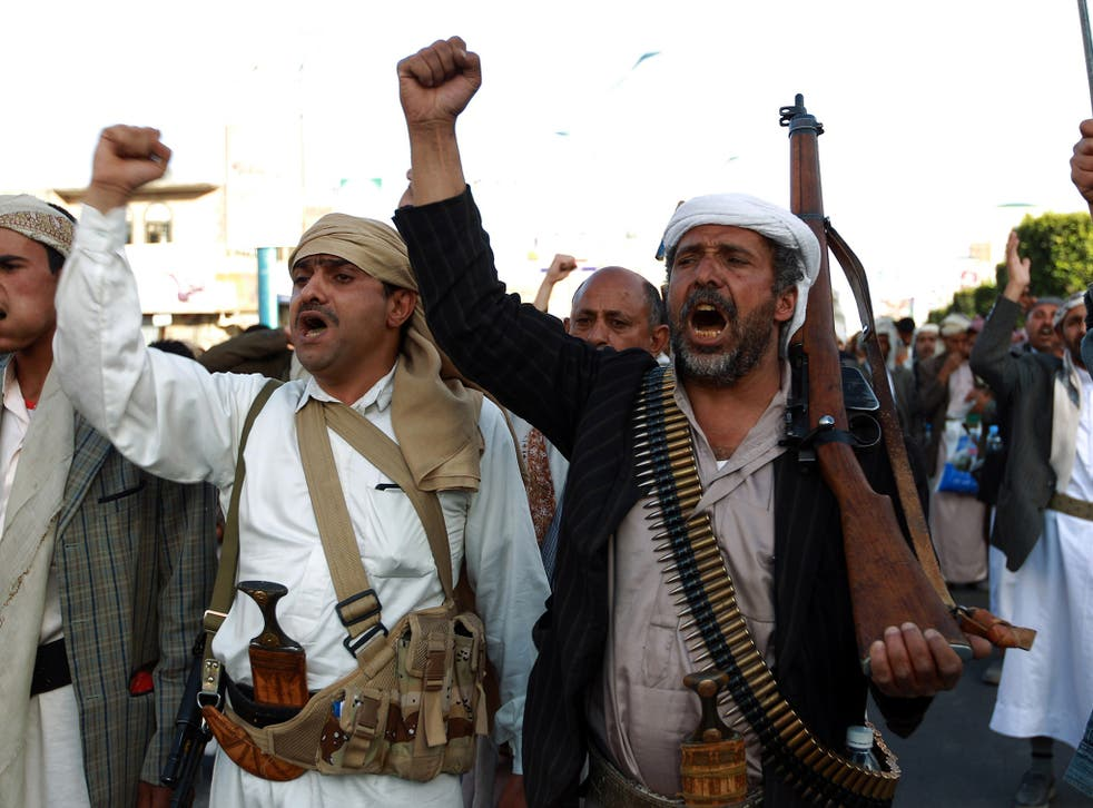 Supporters of the Shiite Houthi movement shout slogans during a rally against US and Saudi intervention in Yemen