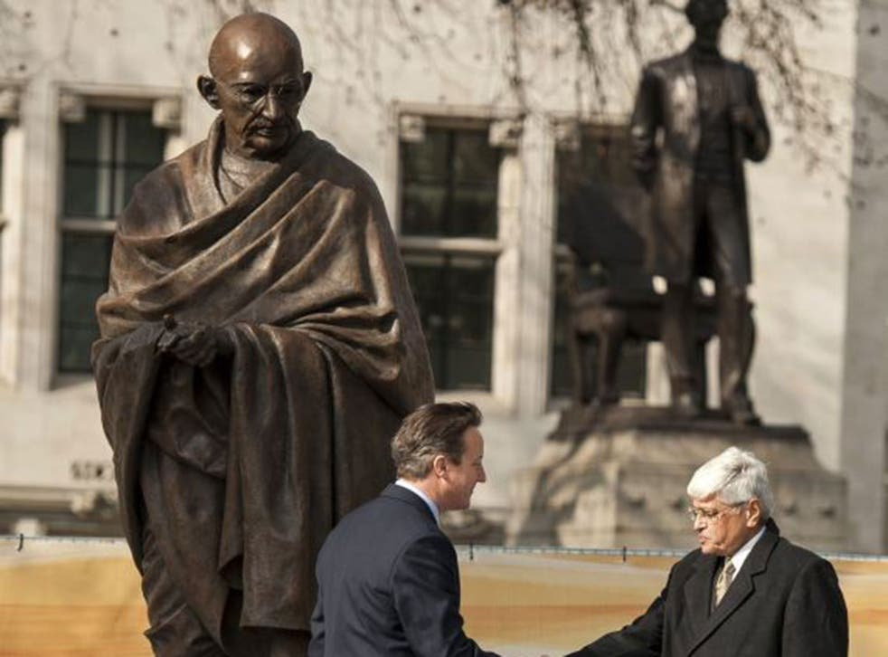 New statue of Gandhi unveiled in Parliament Square. Prime Minister David Cameron shakes hands with Mahatma Gandhi's grandson, Shri Gopalkrishna Gandhi