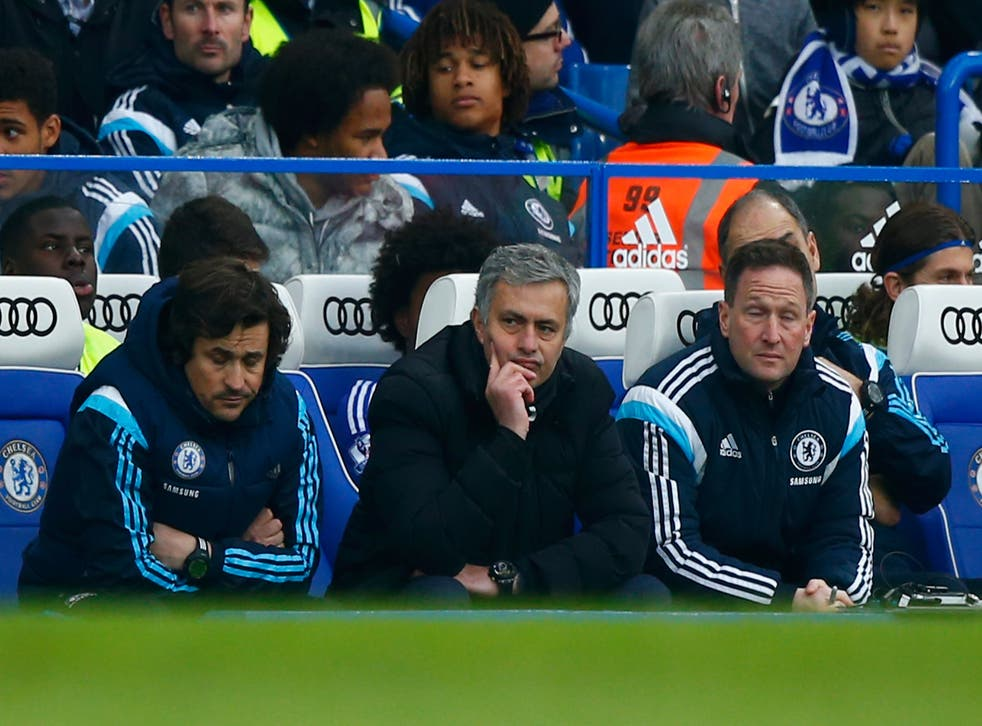 Jose Mourinho looks on from the touchline