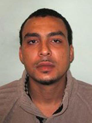 Man sought over body found in boot of burning car dumped