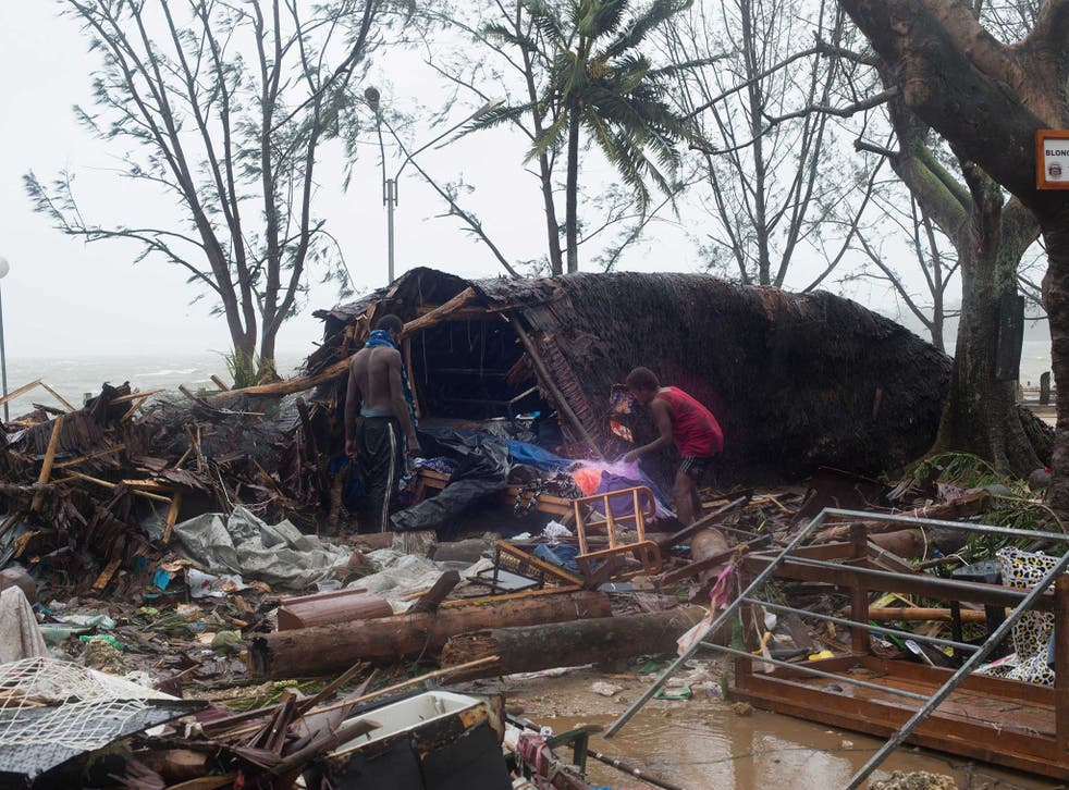 Survivors pick through the wreckage after Cyclone Pam
