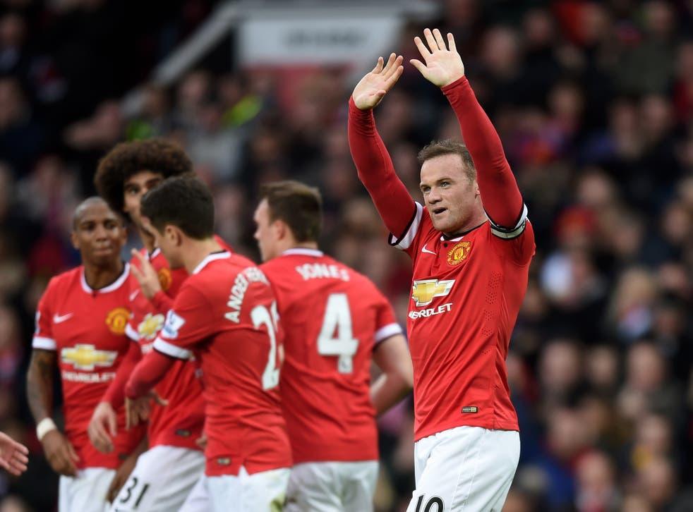 Wayne Rooney celebrates his goal against Tottenham