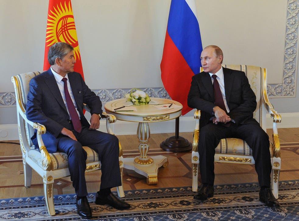 Russian President Vladimir Putin and his Kyrgyz counterpart Almazbek Atambayev attend a meeting in Saint Petersburg