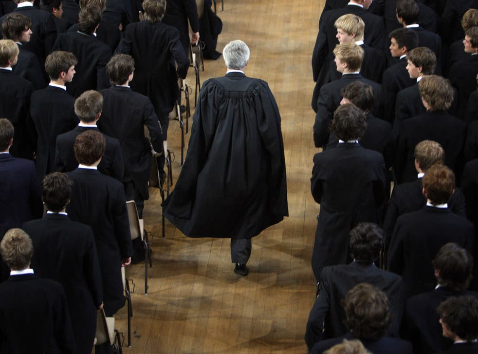 The boys of Eton College stand as headmaster Tony Little arrives for morning assembly