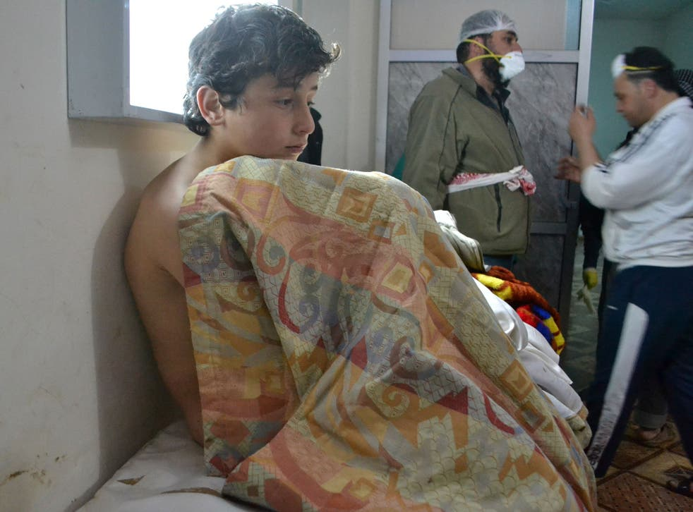 A young man sits on a bed on March 17, 2015 at a clinic in the village of Sarmin, southeast of Idlib, the capital of Syria's northwestern province of Idlib, following reports of suffocation cases related to an alleged regime gas attack in the area