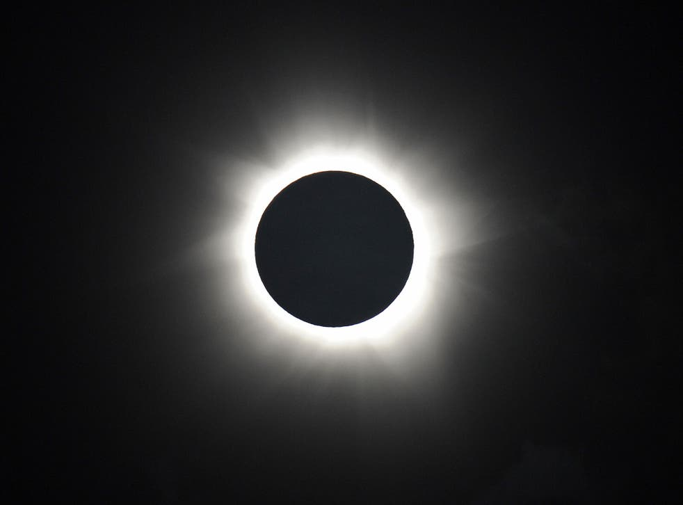 Totality is shown during the solar eclipse at Palm Cove in Australia's Tropical North Queensland