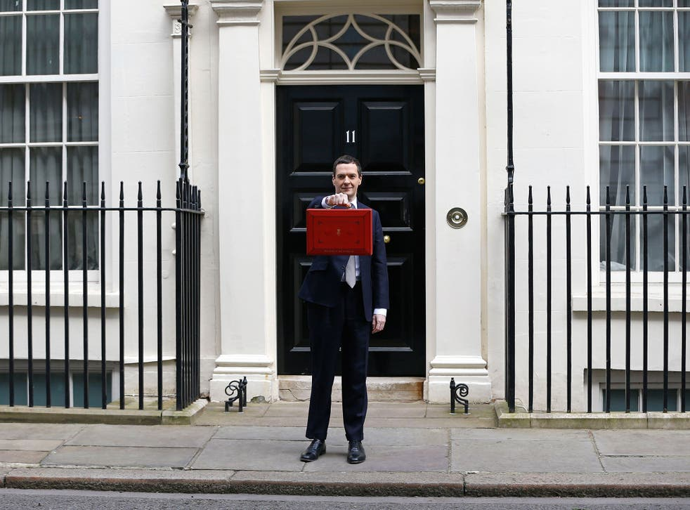 Britain's Chancellor George Osborne stands outside his official residence at 11 Downing Street in London, prior to unveiling the budget