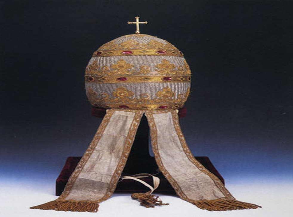 The papal tiara was made out of papier mâché and was decorated with silver cloth and jewels