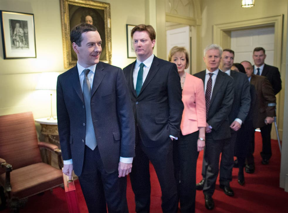Chancellor George Osborne, Chief Secretary to the Treasury Danny Alexander and their treasury team leave 11 Downing Street, London, before heading to the House of Commons to deliver the annual Budget statement