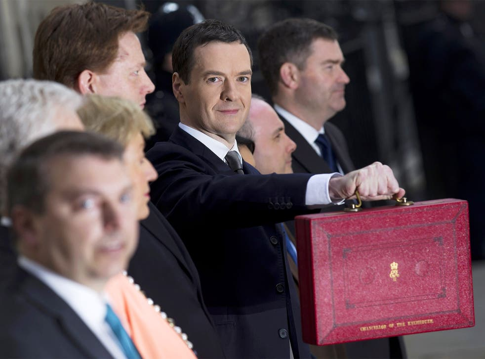 Chancellor George Osborne holds the Budget Box outside 11 Downing Street before unveiling the annual budget
