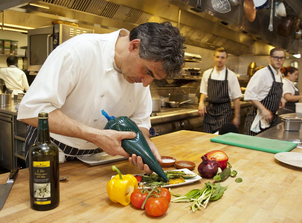 Bruno Loubet puts the finishing touches to a vegetable dish at the Grain Store in King's Cross