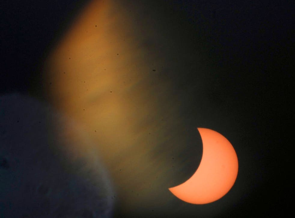 A partial solar eclipse of the sun is visible in Rabat, Morocco