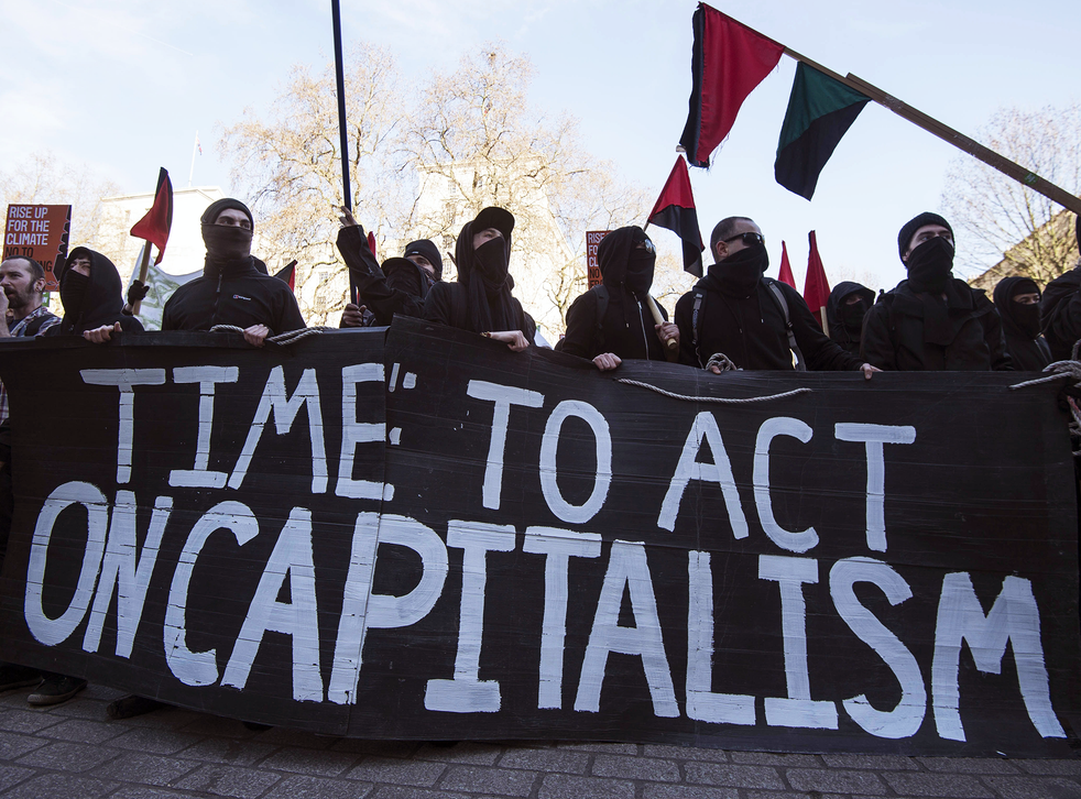 Anti-capitalist demonstrators display a banner outside Downing Street in March, 2015