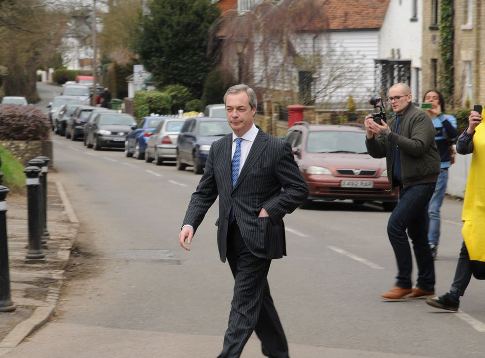 Nigel Farage is pictured leaving the pub after the invasion by protesters