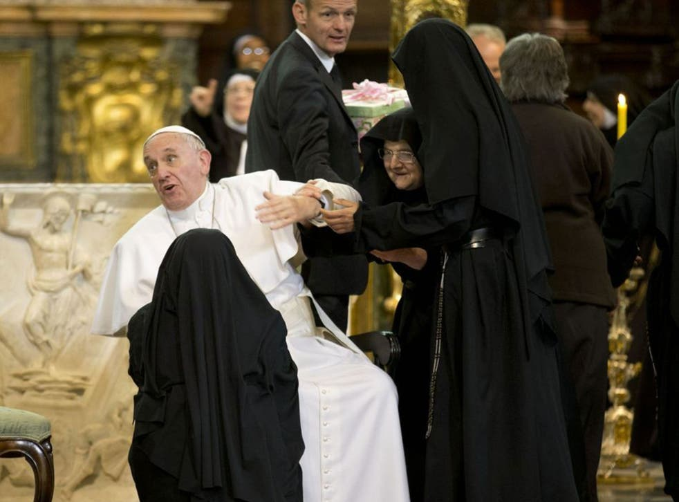 Pope Francis is greeted by nuns as he prepared to give a speech in Naples Cathedral