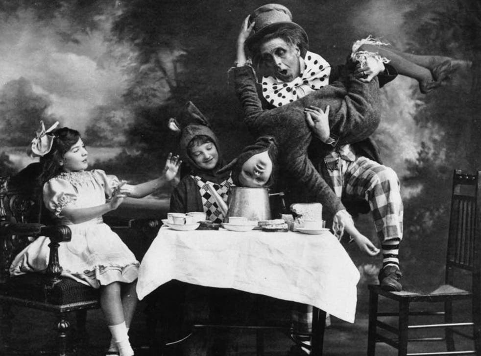 Totally potty: 'Alice in Wonderland' is full of strange scenes, such as the Mad Hatter's tea party, as performed on the London stage in 1910