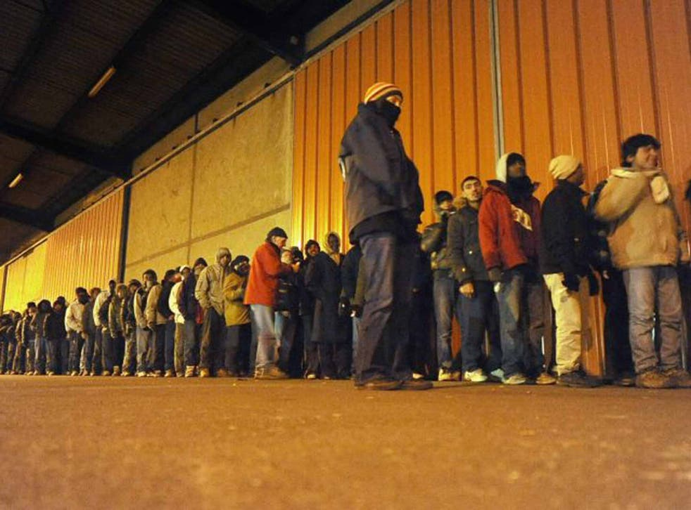 Hard line: migrants queue for food in Calais