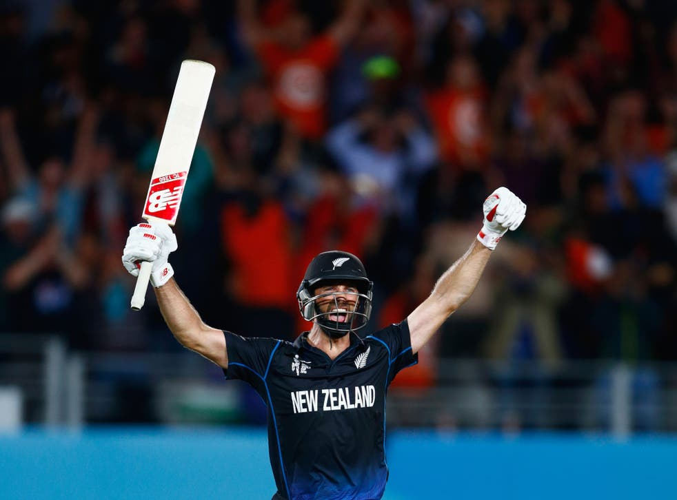Grant Elliott celebrates hitting a six to win the Cricket World Cup semi-final against South Africa