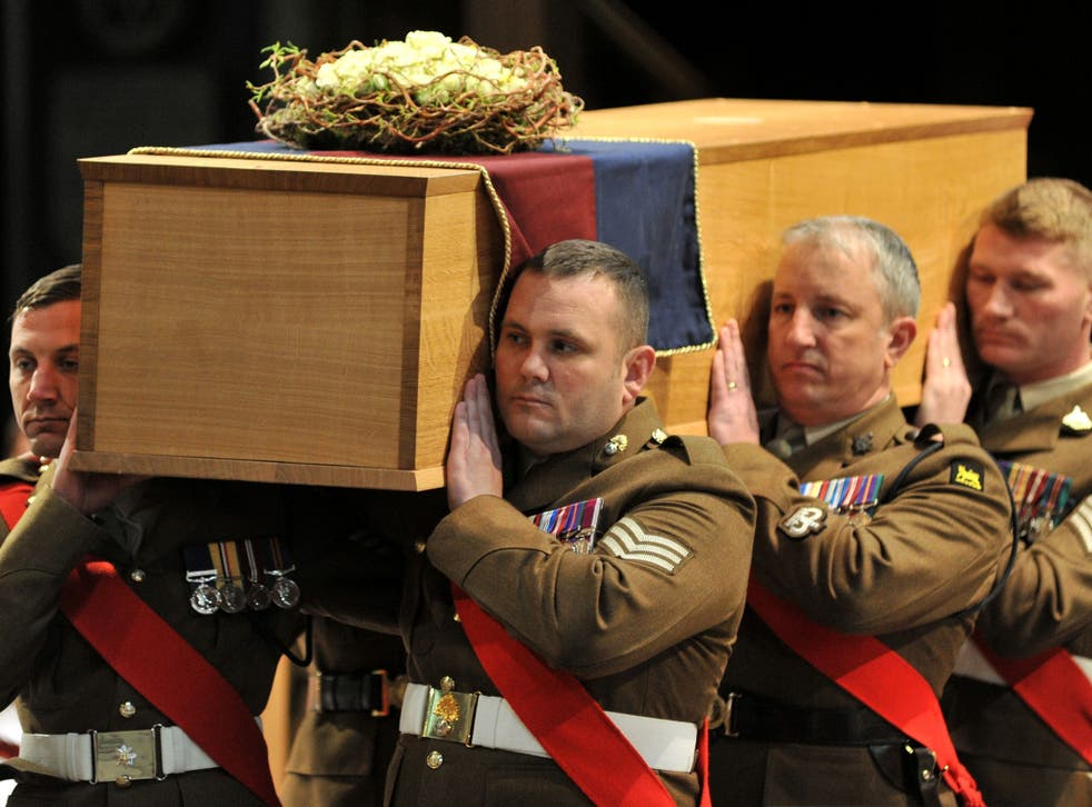 The coffin is carried by the military bearer party during the service for the re-burial of Richard III