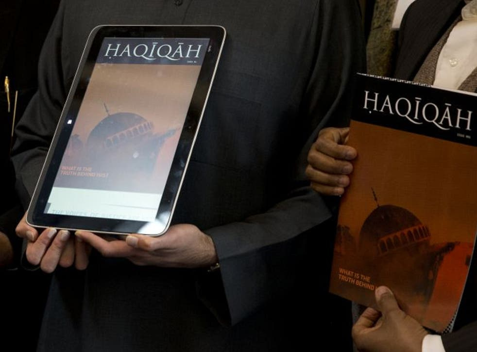 Haqiqah magazine being shown on the iPad and in print during the launch
