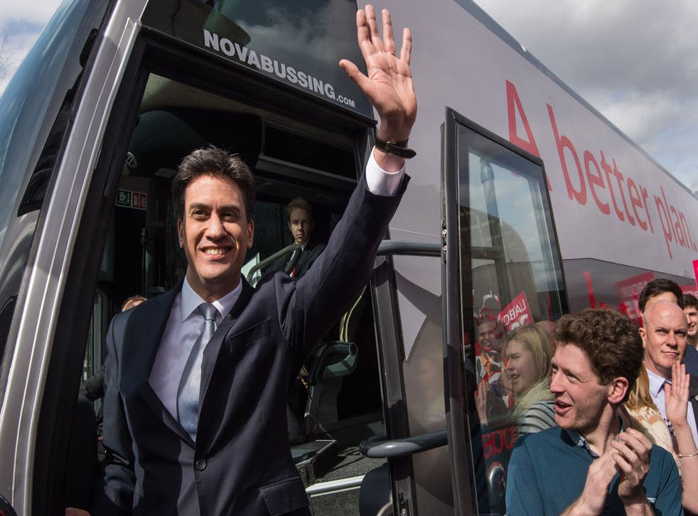 Ed Miliband waves to the crowds as he steps on to Labour's battlebus (PA)