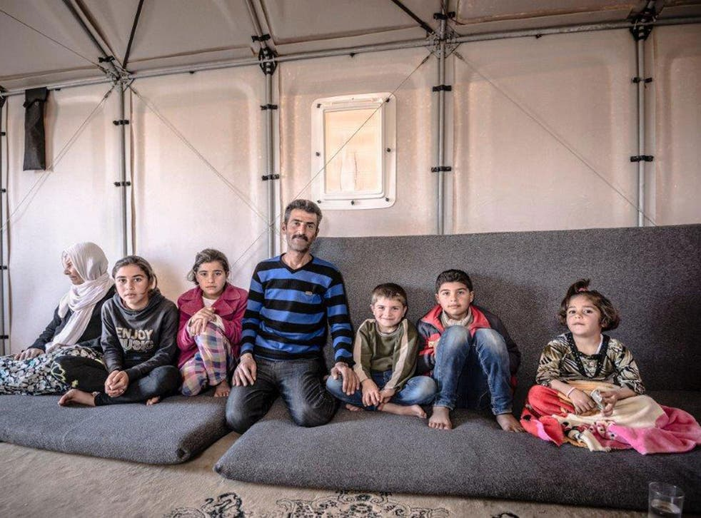 Riyad with sons, daughters and mother in law inside a Better Shelter prototype, Kawergosk refugee camp, Iraq, March 2015