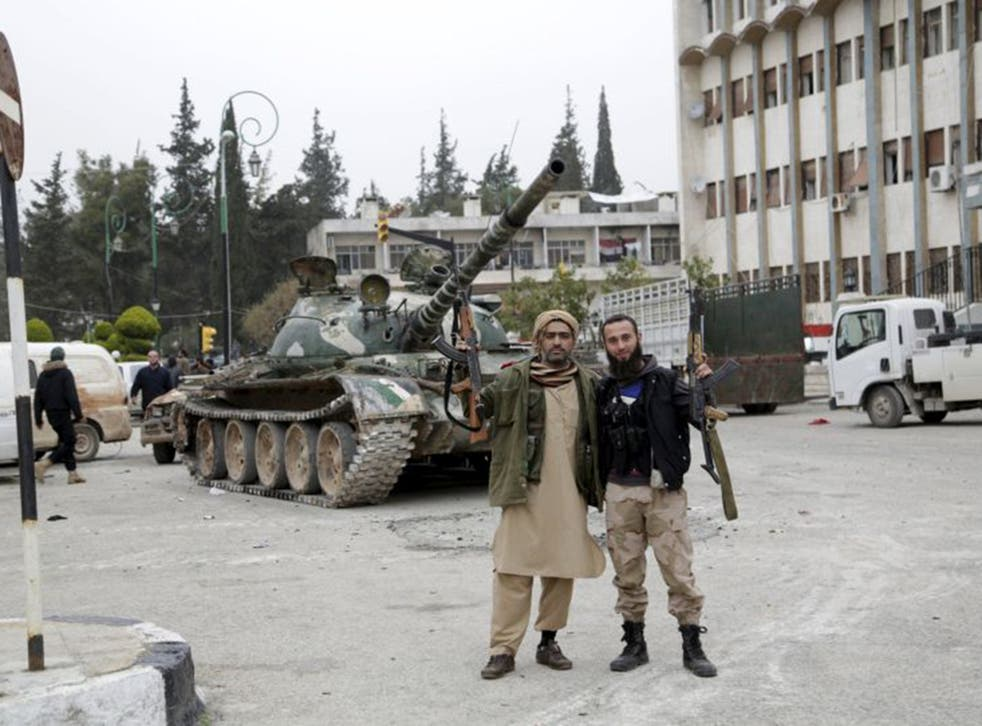 Jabhat al-Nusra's fighters pose for a picture after the militants stormed Idlib on Saturday