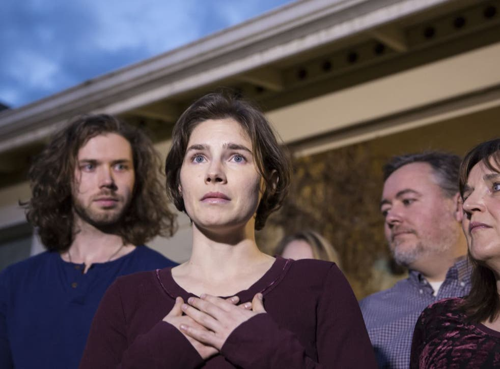 Amanda Knox speaks at her parents' home in Seattle on Friday, flanked by her fiancé, Colin Sutherland, and her mother, Edda Mellas