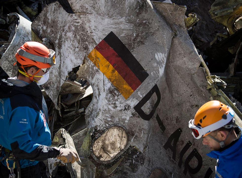 Investigators pick through the wreckage of the Germanwings air crash in March 2015. The co-pilot, who had been treated for depression, deliberately flew the plane into a mountain
